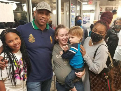 Bishop Eusebio Phelps helps raise money for Hannah Hill, a pregnant waitress at Waffle House in Henry County, Georgia.
