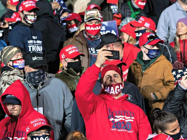 Supporters of US President Donald Trump attend a Make America Great Again rally as he campaigns at Erie International Airport in Erie, Pennsylvania, October 20, 2020. (Photo by SAUL LOEB / AFP) (Photo by SAUL LOEB/AFP via Getty Images)