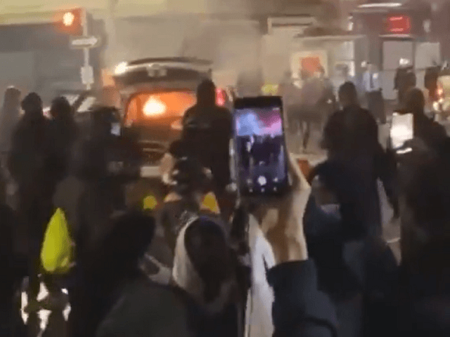 Rioters set police car on fire in Philadelphia. (Twitter Video Screenshot)