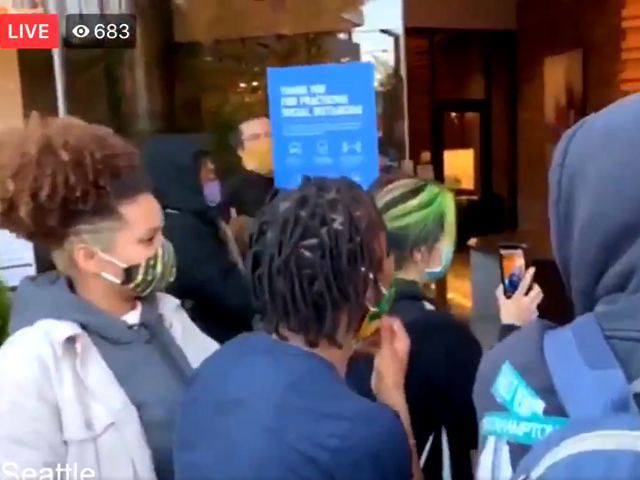 Seattle police make arrests after protesters invade KING5 NBC lobby on Thursday evening. (Twitter Video Screenshot)