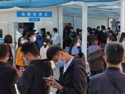 People line up to be tested for the COVID-19 coronavirus in Yantai, in China's eastern Shandong province on October 12, 2020, following a new outbreak of the coronavirus in the nearby city of Qingdao. (Photo by STR / AFP) / China OUT (Photo by STR/AFP via Getty Images)