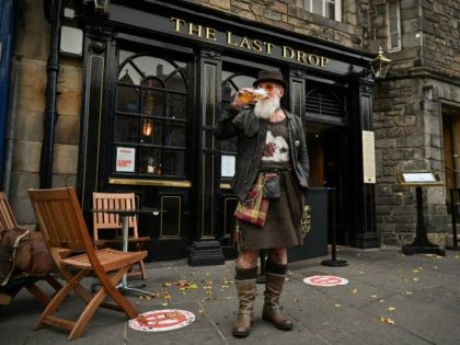 EDINBURGH, SCOTLAND - OCTOBER 07: Charles Douglas Barr enjoys a pint outside The Las Drop pub in the Grassmarket on October 7, 2020 in Edinburgh, Scotland. New restrictions aimed at slowing a surge in coronavirus cases are to be announced by Scotland's first minister Nicola Sturgeon. (Photo by Jeff J …