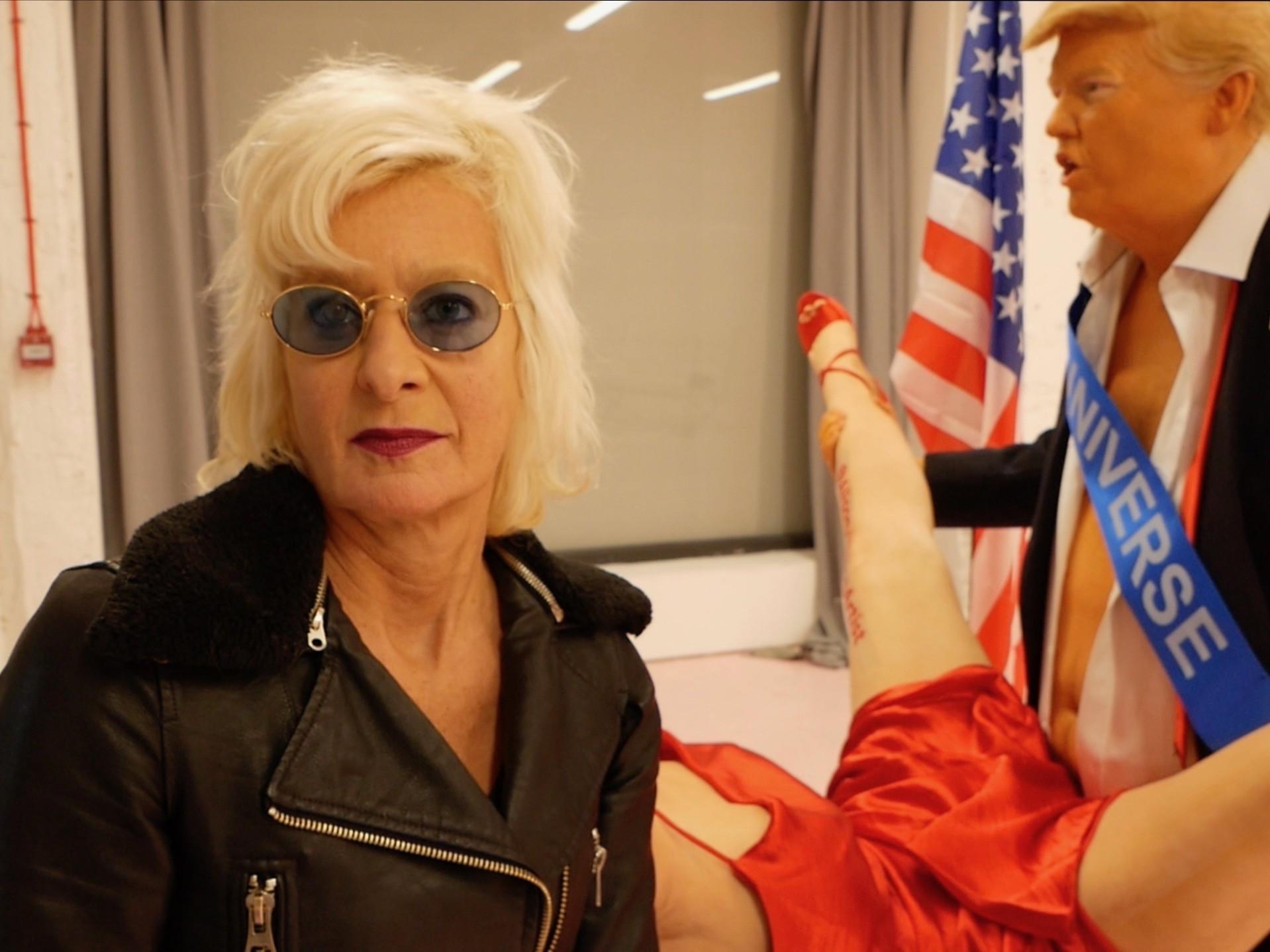 British artist Alison Jackson stands in front of her 'Official Presidential Send Off' sculpture, October 28, 2020. Kurt Zindulka, Breitbart News