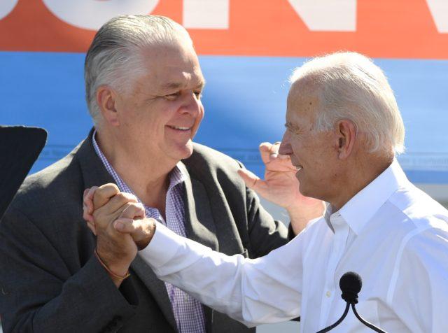 Sisolak and Biden (Ethan Miller / Getty)