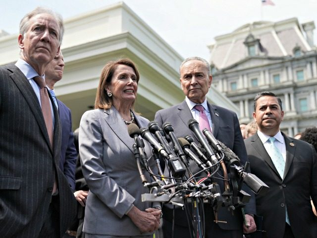 WASHINGTON, DC - APRIL 30: Congressional Democrats, including (L-R) House Ways and Means Committee Chairman Richard Neal (D-MA), Senate Finance Committee ranking member Sen. Ron Wyden (D-OR), Speaker of the House Nancy Pelosi (D-CA), Senate Minority Leader Charles Schumer (D-NY) and Rep. Ben Ray Lujan (D-NM), talk to reporters following …