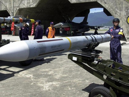 HUALIEN, TAIWAN: A ground crew of Taiwan's air force prepares to load a Sparrow air-to-air missile onto an F-16 fighter deployed in the eastern Hualien airbase, 17 August 2004. The air force confirmed it had carried out its first test firing of US-made Harpoon anti-ship missiles in a display of …