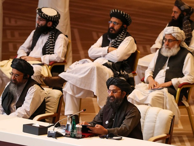 Taliban co-founder Mullah Abdul Ghani Baradar (R, bottom) speaks during the opening session of the peace talks between the Afghan government and the Taliban in the Qatari capital Doha on September 12, 2020. (Photo by KARIM JAAFAR / AFP) (Photo by KARIM JAAFAR/AFP via Getty Images)