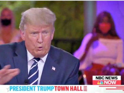 The Nodding Woman Behind Trump