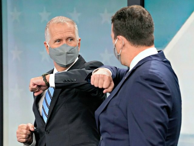 U.S. Sen. Thom Tillis, R-N.C., left, and Democratic challenger Cal Cunningham greet each other prior to a televised debate at WNCN-TV in Raleigh, N.C., Tuesday, Sept. 22, 2020. (AP Photo/Gerry Broome)
