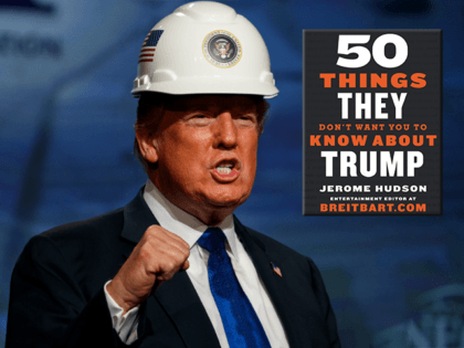 President Donald Trump pumps his fist after putting on a hard hat given to him before speaking to the National Electrical Contractors Association Convention at the Pennsylvania Convention Center, Tuesday, Oct. 2, 2018, in Philadelphia. (AP Photo/Evan Vucci)