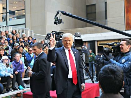 NEW YORK, NY - APRIL 21: Republican presidential candidate Donald Trump waves while appearing at an NBC Town Hall at the Today Show on April 21, 2016 in New York City. The GOP front runner appeared with his wife and family and took questions from audience members. (Photo by Spencer …
