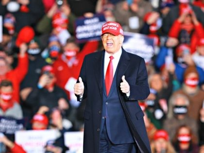 MUSKEGON, MI - OCTOBER 17: U.S. President Donald Trump gestures during a campaign rally on October 17, 2020 in Muskegon, Michigan. President Trump has ramped up his schedule of public events as he continues to campaign against Democratic presidential nominee Joe Biden ahead of the November election. (Photo by Rey …