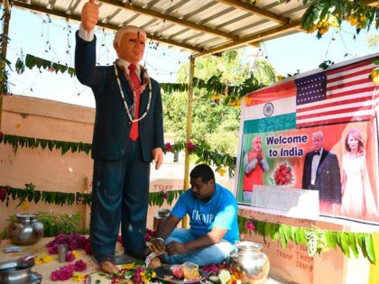 In this photo taken on February 17, 2020, farmer Bussa Krishna, 33, gives offerings to the statue of US President Donald Trump, at his residence in Jangaon district in Telangana state, some 120 kms from Hyderabad, ahead of the visit of US President Donald Trump to India. - Die-hard Donald …