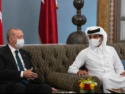 In this photo released by the Qatar Amiri Diwan, Turkish President Recep Tayyip Erdogan, left, meets with the Emir of Qatar Sheikh Tamim bin Hamad Al Thani, in Doha, Qatar, Wednesday, Oct. 7, 2020. (Qatar Amiri Diwan via AP)