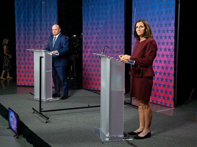 US Senator Martha McSally (R-AZ) (R) and Democratic challenger Mark Kelly are separated by plexiglass as they participate in a debate at the Walter Cronkite School of Journalism at Arizona State University in Phoenix, Arizona, on October 6, 2020. (Photo by Rob SCHUMACHER / POOL / AFP) (Photo by ROB …