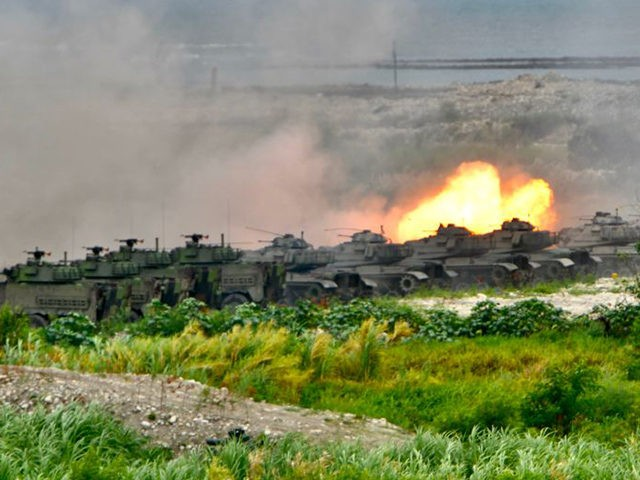"US-made M60A3 tanks fire artillery during the annual Han Kuang military drills in Taichung on July 16, 2020. - The five-day ""Han Kuang"" (Han Glory) military drills starting on July 14 aimed to test how the armed forces would repel an invasion from China, which has vowed to bring Taiwan …"