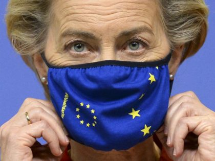 European Commission President Ursula von der Leyen adjusts her facemask ahead of delivering a statement ahead of the first day of a European Union (EU) summit at The European Council Building in Brussels on October 1, 2020. - EU chief Ursula von der Leyen declared October 1, 2020, that Brussels …