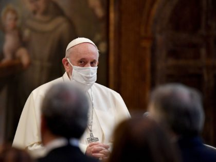 Pope Francis wearing a protective face mask, attends an inter-religious prayer service for peace along with other religious representatives in the Basilica of Santa Maria in Aracoeli, a church on top of Rome's Capitoline Hill, on October 20, 2020 in Rome. (Photo by Andreas SOLARO / AFP) (Photo by ANDREAS …