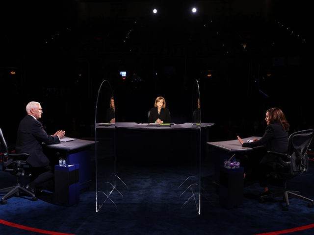 SALT LAKE CITY, UTAH - OCTOBER 07: Democratic vice presidential nominee Sen. Kamala Harris (D-CA) and U.S. Vice President Mike Pence participate in the vice presidential debate moderated by Washington Bureau Chief for USA Today Susan Page (C) at the University of Utah on October 7, 2020 in Salt Lake …