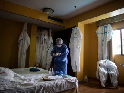 CARACAS, VENEZUELA - JULY 20: A medical staff member organizes gear inside an isolated room and decontaminates in the hotel converted to a hospital for COVID-19 positive people who do not need hospitalization during week 19 of radical quarantine on July 20, 2020 in Caracas, Venezuela. To manage hospital occupation …