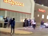 Looters Beat Police Officer with Stolen Cash Register During DC Protest
