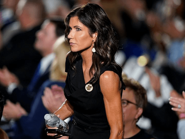 In this Aug. 27, 2020 file photo, South Dakota Gov. Kristi Noem stands in the crowd on the South Lawn of the White House during the fourth day of the Republican National Convention in Washington. Noem has no plans to get tested for the coronavirus before heading back to the …