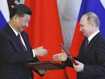 XI Jinping and Vladimir Putin (Sergei Ilnitsky / Pool via Associated Press)
