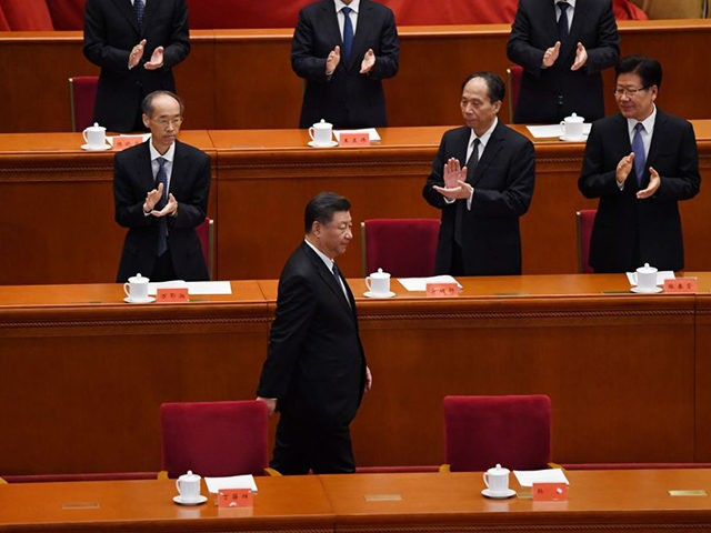 TOPSHOT - Chinese President Xi Jinping is applauded as he arrives for a ceremony marking the 70th anniversary of China's entry into the Korean War, in Beijing's Great Hall of the People on October 23, 2020. (Photo by NOEL CELIS / AFP) (Photo by NOEL CELIS/AFP via Getty Images)