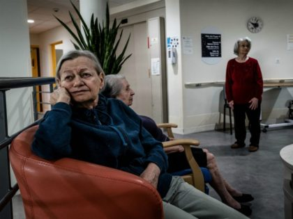 In this photograph taken on October 1, 2020, elderly residents gather in a common area at The Vilanova Care Home in Corbas, south-eastern France. - In mid-March, the Ehpad Vilanova, which opened in February 2018, was one of the first in France to confine staff and residents, so as not …