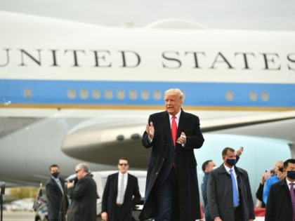 US President Donald Trump(C) arrives to speak during a campaign rally at Manchester-Boston Regional Airport in Londonderry, New Hampshire on October 25, 2020. - Donald Trump's reelection campaign on Sunday sought to brush off another Covid outbreak in his team by focusing its attacks on Joe Biden's energy levels and …