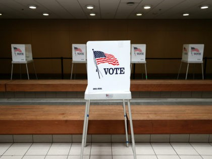 SAN JOSE, CALIFORNIA - OCTOBER 13: A view of voting booths at the Santa Clara County registrar of voters office on October 13, 2020 in San Jose, California. The Santa Clara County registrar of voters is preparing to take in and process thousands of ballots as early voting is underway …