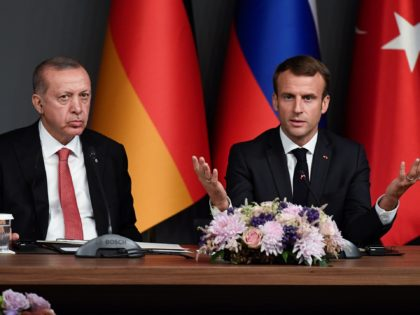 Turkish President Recep Tayyip Erdogan (L) and President Emmanuel Macron attend a conference as part of a summit called to attempt to find a lasting political solution to the civil war in Syria which has claimed in excess of 350 000 lives, at Vahdettin Mansion in Istanbul, on October 27, …
