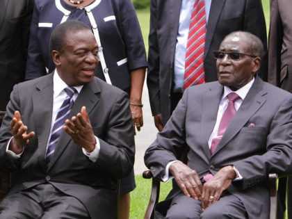 Emmerson Mnangagwa, left, Vice President of Zimbabwe chats with Zimbabwean President Robert Mugabe after the swearing in ceremony at State House in Harare, Friday, Dec, 12, 2014. Mnangagwa was sworn in following a cabinet reshuffle that saw former deputy President Joice Mujuru dismissed from her post, over allegations that she …