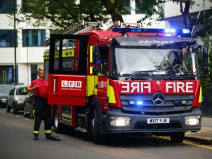 A fire engine parks outside Braithwaite House residential block in Islington in north London on June 24, 2017. Residents of 650 London flats were evacuated due to fire safety fears in the wake of the Grenfell Tower tragedy, but 83 people refused to leave their homes, according to local officials. …