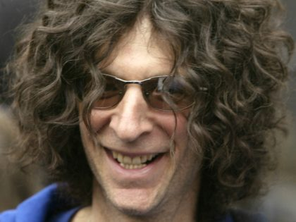 Radio host Howard Stern, smiles while handing out Sirius radios to fans in Union Square in New York Thursday, Nov. 18, 2004. The promotional event was geared to keep Stern's fans as his show makes the switch to satellite radio. (AP Photo/Gregory Bull)