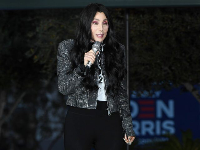 LAS VEGAS, NEVADA - OCTOBER 24: Singer/actress Cher campaigns for Joe Biden and Kamala Harris at an early vote rally at a residential shopping center on October 24, 2020 in Las Vegas, Nevada. In-person early voting for the general election in the battleground state began on October 17 and continues …