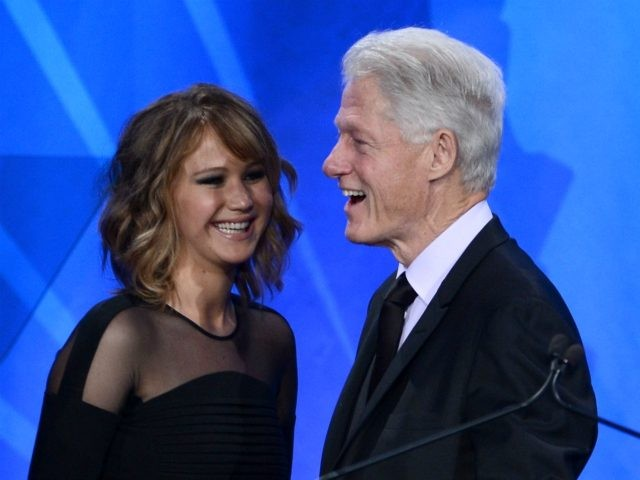 LOS ANGELES, CA - APRIL 20: Actress Jennifer Lawrence presents Former President of the United States Bill Clinton with the Advocate for Change Award onstage during the 24th Annual GLAAD Media Awards at JW Marriott Los Angeles at L.A. LIVE on April 20, 2013 in Los Angeles, California. (Photo by …