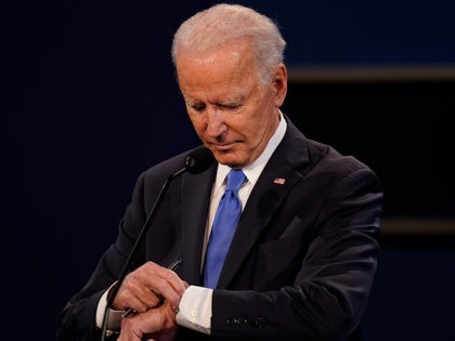Democratic presidential candidate former Vice President Joe Biden checks his watch during the second and final presidential debate Thursday, Oct. 22, 2020, at Belmont University in Nashville, Tenn., with President Donald Trump. (AP Photo/Patrick Semansky)