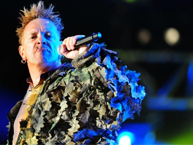 Johnny Rotten, British singer of the Sex Pistols' punk band performs on July 6, 2008 at the Terres Neuvas music festival in Bobital, western France. AFP PHOTO FRED TANNEAU (Photo credit should read FRED TANNEAU/AFP via Getty Images)