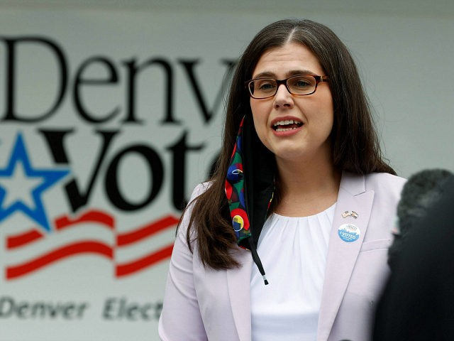 FILE - In this June 30, 2020, file photo, Colorado Secretary of State Jena Griswold makes a point during a news conference at a mobile voting location in the Swansea neighborhood in Denver. Colorado is expanding its mail-in ballot tracking app so that all voters in the state can use …