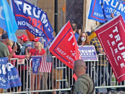 President Donald Turmp supporters gather outside Walter Reed National Military Medical Center in Bethesda, Md., Sunday, Oct. 4, 2020. Trump was admitted to the hospital after contracting COVID-19. (AP Photo/Anthony Peltier)