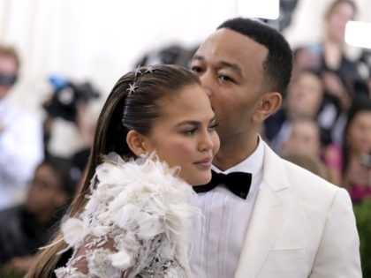 Chrissy Teigen, left, and John Legend attend The Metropolitan Museum of Art's Costume Institute benefit gala celebrating the opening of the Rei Kawakubo/Comme des Garçons: Art of the In-Between exhibition on Monday, May 1, 2017, in New York. (Photo by Charles Sykes/Invision/AP)