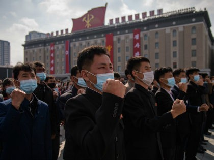 In a photo taken on October 12, 2020 participants wearing face masks attend a rally marking the start of an '80-day Campaign' in support of the upcoming 8th Congress of the Workers' Party of Korea (WPK) to be held in January 2021, at Kim Il Sung Square in Pyongyang. (Photo …