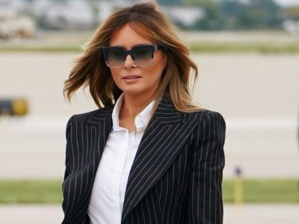US President Donald Trump and First Lady Melania Trump step off Air Force One upon arrival at Cleveland Hopkins International Airport in Cleveland, Ohio on September 29, 2020. - President Trump announced early on October 2, 2020, that he and First Lady Melania Trump would be going into quarantine after …