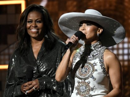LOS ANGELES, CALIFORNIA - FEBRUARY 10: (L-R) Michelle Obama and Jennifer Lopez speak onstage during the 61st Annual GRAMMY Awards at Staples Center on February 10, 2019 in Los Angeles, California. (Photo by Kevork Djansezian/Getty Images)