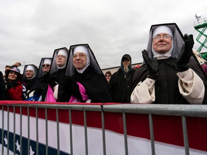 Nuns with the Dominican Sisters of Hartland, Mich., applaud as President Donald Trump speaks at a campaign rally at Oakland County International Airport, Friday, Oct. 30, 2020, at Waterford Township, Mich. (AP Photo/Alex Brandon)