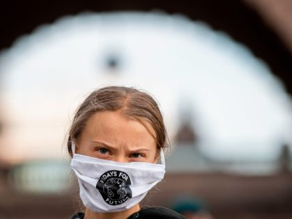 TOPSHOT - Swedish climate activist Greta Thunberg takes part in a Fridays For Future protest in front of the Swedish Parliament (Riksdagen) in Stockholm on September 25, 2020. (Photo by JONATHAN NACKSTRAND / AFP) (Photo by JONATHAN NACKSTRAND/AFP via Getty Images)