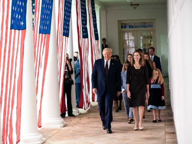 President Donald J. Trump walks with Judge Amy Coney Barrett, his nominee for Associate Justice of the Supreme Court of the United States, along the West Wing Colonnade on Saturday, September 26, 2020, following announcement ceremonies in the Rose Garden. (Official White House Photo by Shealah Craighead)