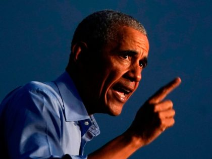 Former US President Barack Obama addresses Biden-Harris supporters during a drive-in rally in Philadelphia, Pennsylvania on October 21, 2020. - Former US president Barack Obama hit the campaign trail for Joe Biden today in a bid to drum up support for his former vice president among young Americans and Black …