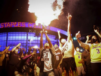 Los Angeles Lakers fans celebrate outside of Staples Center, Sunday, Oct. 11, 2020, in Los Angeles, after the Lakers defeated the Miami Heat in Game 6 of basketball's NBA Finals to win the championship. (AP Photo/Christian Monterrosa)
